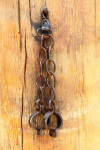 Bondage shackles on a dungeon wall