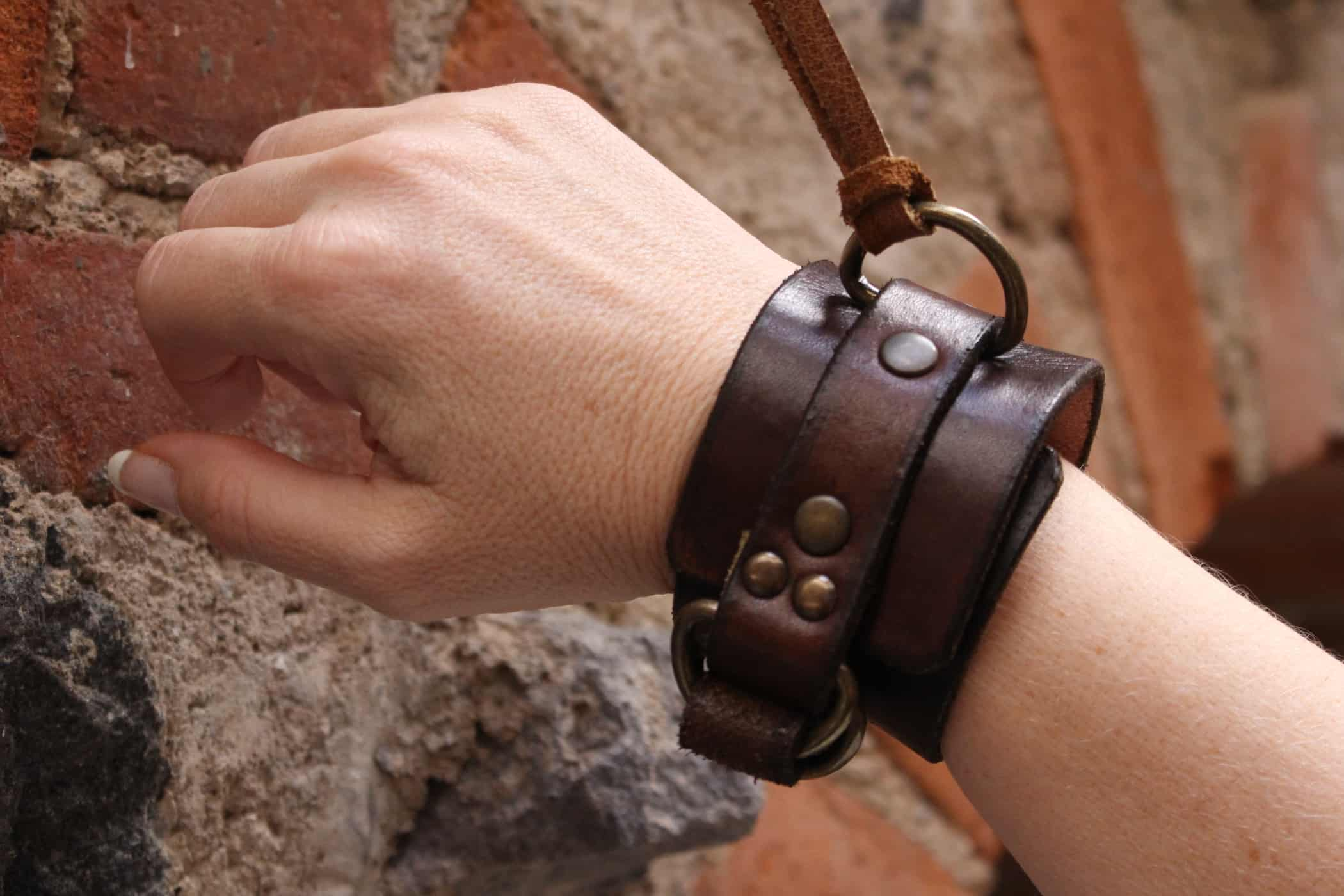 Authentic leather dungeon cuffs